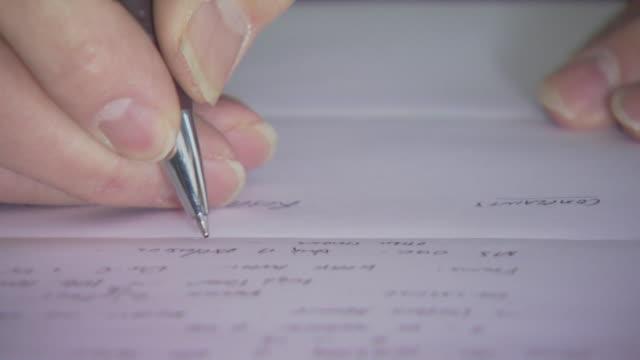 Man writing very close up, USA
