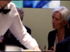 Managing Director of the International Monetary Fund Christine Lagarde ZI Lagarde talking with colleagues having coffee / MS Lagarde brushing her...