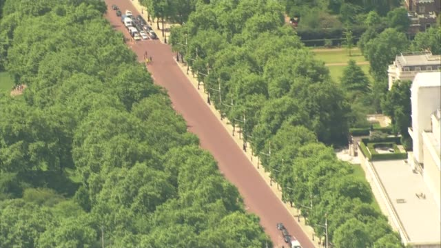 Aerials of security in London ENGLAND London Downing Street gates with police officers standing / The Mall / Buckingham Palace / barriers outside...