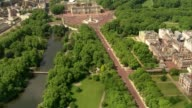 Aerials of security in London ENGLAND London St James's Park and Buckingham Palace / mounted guards along by Victoria memorial and along towards and...