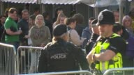 Charity concert marks reopening of venue Armed police patrolling outside Manchester Arena Policeman and police woman kissing as people queue Various...