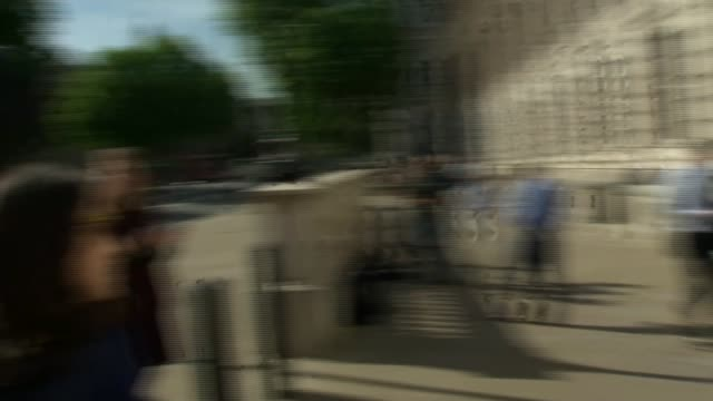 COBRA arrivals ENGLAND London Whitehall EXT Officials arriving and into Cabinet Office / Sajid Javid along / Chris Grayling arrival / Michael Fallon...