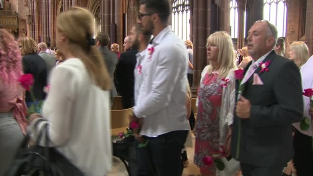 Funeral of Saffie Roussos ENGLAND Manchester Manchester Cathedral INT Coffin of Saffie Rose Roussos being carried into church followed by mourners /...