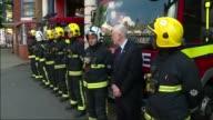 Jeremy Corbyn minute's silence ENGLAND London Islington EXT Jeremy Corbyn arrival at Islington Fire Station / Jeremy Corbyn standing with...