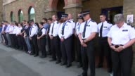 Minute's silence at Islington Police Station ENGLAND London Islington Islington Police Station EXT Police officers and staff stand for minute silence...