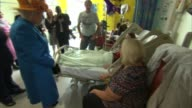 Queen visits injured in hospital ***BEWARE Queen Elizabeth II along chatting with various nurses and paramedics / Queen into hospital ward and...