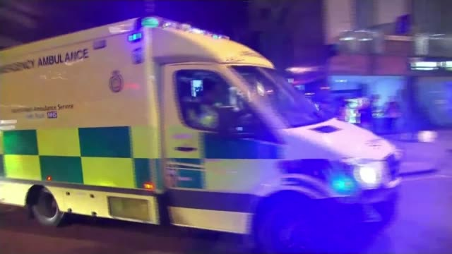 scale of injuries revealed / arrest warrant for bomber's brother T23051702 / TX Manchester Ambulance along People after attack