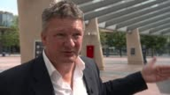 Security stepped up across UK London North Greenwich Steve Parks interview SOT Arena INT Various of people going through airportstyle security check...