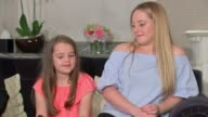 Victim reunited with police officer who helped saved her Manchester Lily Harrison interview SOT Lily Harrison and mother along Lily in car and waving