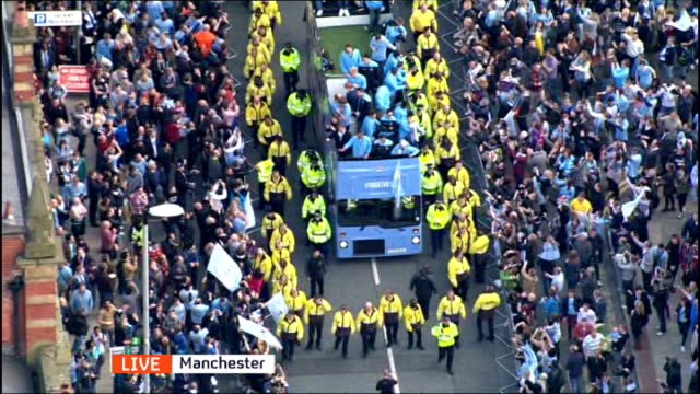 Manchester City victory parade following Premier League win AIR VIEW / AERIAL of Manchester City players and staff on opentopped bus journey through...