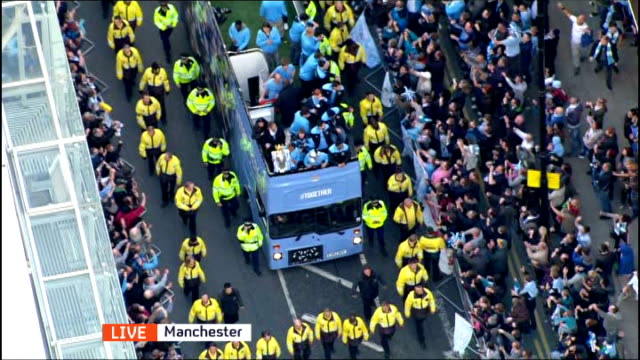 Manchester City victory parade following Premier League win CUTAWAY Victory bus with players along road