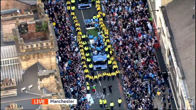 Manchester City victory parade following Premier League win ENGLAND Manchester Victory bus with players along road