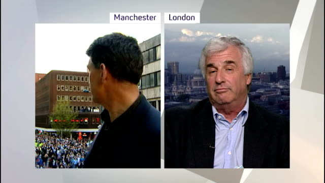 Manchester City victory parade following Premier League win SPLIT SCREEN Between reporter in Manchester and Shindler in London EXT Reporter to camera