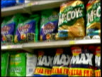 ITN ENGLAND Manchester INT Mother and children in crisps aisle of supermarket Multipack of crisps placed in trolley by boy Crisps on shelves TILT...