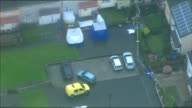 Aerials of crime scene ENGLAND Manchester Abbey Gardens Aerials of Abbey Gardens including house with forensic tents outside and police vehicles on...