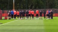 Manchester United players hold a minute's silence to mark last night's terrorist attack at the Manchester Arena
