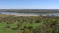 WS AERIAL POV Mandan earthlodge village at Fort Abraham Lincoln State Park / Mandan, North Dakota, United States