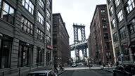 Manhattan bridge through buildings