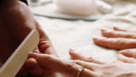 Manicurist Shaping Nails