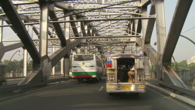 POV of Manila traffic crossing bridge