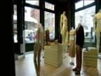Mannequins displaying clothes in designer boutique New York