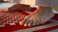 HD: Man's Feet On A Prayer Mat