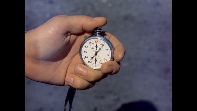CU Man's hand holding stopwatch / United States