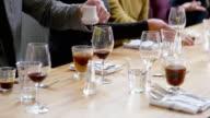 CU PAN mans hand stirring sugar in coffee at table in restaurant
