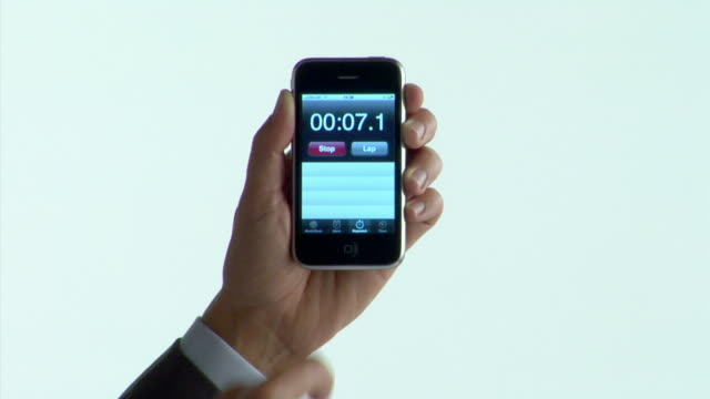 CU man's hand using stopwatch application on mobile phone / starts and stops timer / London