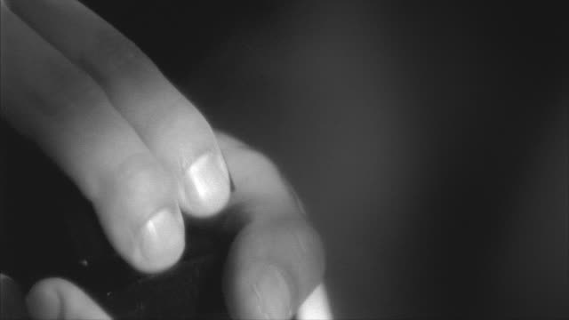 B/W, CU, Man's hands opening jewelry box with diamond ring, Rockford, Illinois, USA