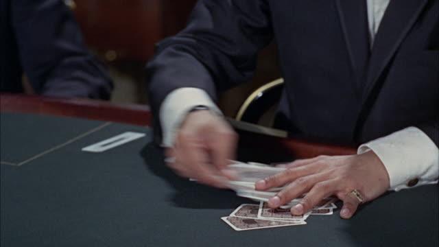 1966 CU Man's hands shuffling deck of cards