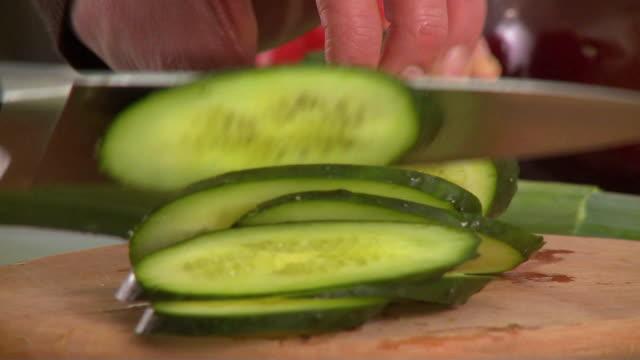 CU Man's hands slicing fresh cucumber / Slovenia