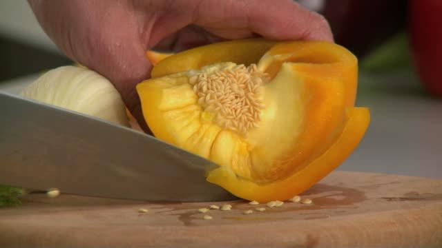CU Man's hands slicing yellow pepper / Slovenia