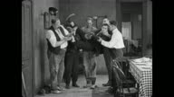 Buster Keaton's new wife drags him home to meet her brothers who manhandle a bewildered Keaton