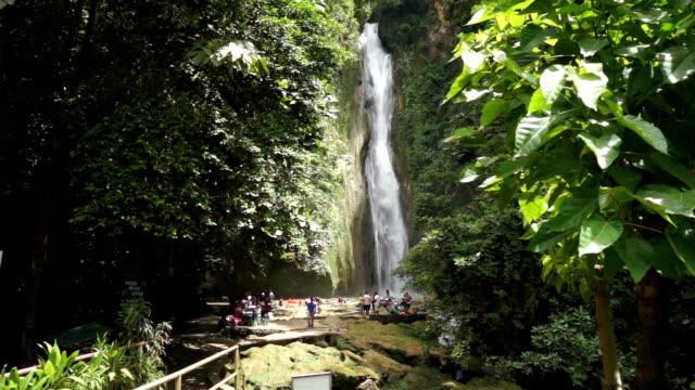 Mantayupan Falls with bridge foreground