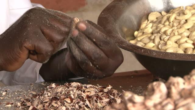 Manual cashew peeling