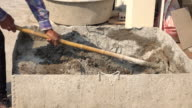 Manual cement mixer with construction worker