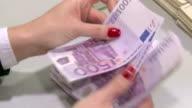 Manual counting Euro banknotes