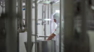 Manual worker mixing dairy in a container