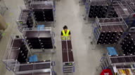 Manual workers and supervisors in warehouse