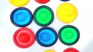 Many brightly coloured condoms