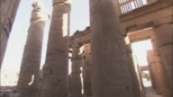 Many columns comprise ancient ruins in Karnak, Egypt.