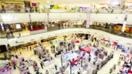 Many poeple in shopping mall,Panning shot