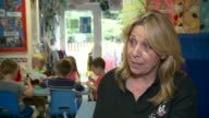 Many working parents could miss out on 30 hours free childcare Oxfordshire INT Children seated at table with teacher in nursery/ Sue Johnson...