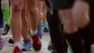 Marathon running race with people feet