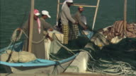 Marawah Marine Protected Area, island, fishermen getting their nets ready, Abu Dhabi, United Arab Emirates