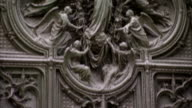 Marble sculptures decorate an exterior wall of the Milan Cathedral. Available in HD.
