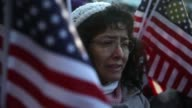 Marcela Alvarado of Gaithersburg Maryland listens during the rally to a live broadcast of President Barack Obama's remarks on immigration from an...
