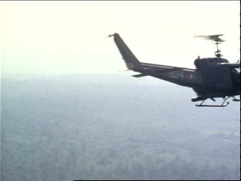 March 13 1971 WS helicopter flying and firing weapons on the Tan Son Nhut Air Base / Ho Chi Minh City Vietnam