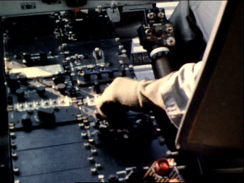 March 13 1971 HA pilot's hand adjusting controls in a gunship flying at Tan Son Nhut Air Base / Saigon Vietnam